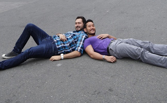 Two men reclining on ground