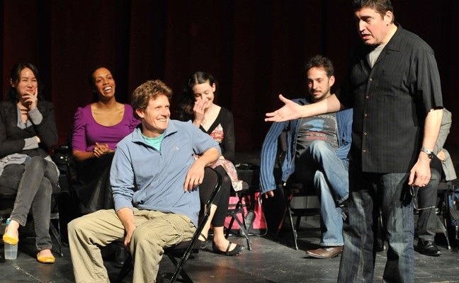 Actor Alfred Molina (standing, right) speaks to students.