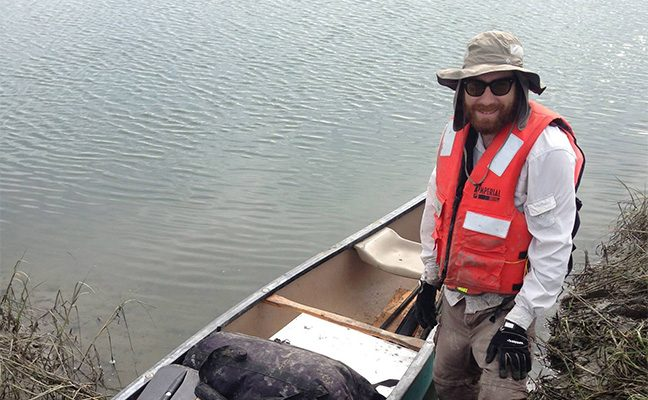 Ph.D. candidate Jordan Rosencranz conducts research with the U.S. Geological Survey.