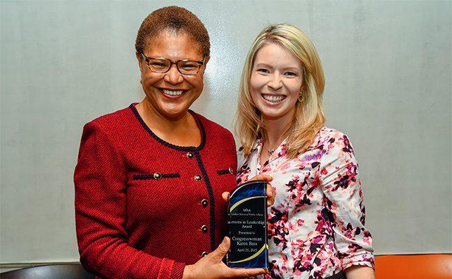 Congresswoman Karen Bass, with mentee, holding award