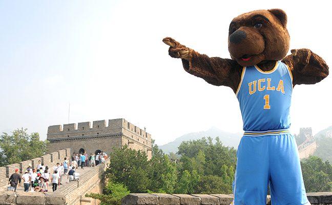 Mascot Joe Bruin poses at the Great Wall of China