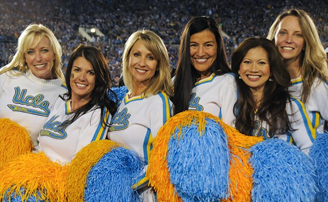 Six Spirit Squad members pose at a football game