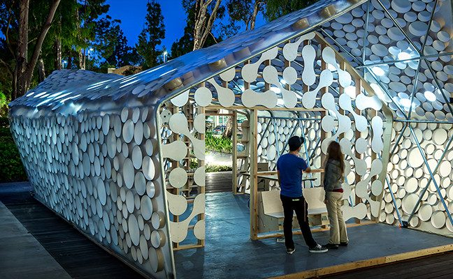 Man and woman standing outside concept model for sustainable home construction