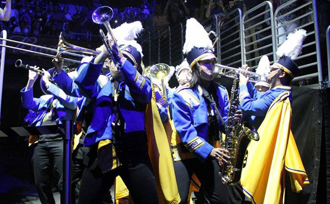 Marching band members opened for rock and roll legends the Rolling Stones in 2013.