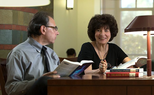 Older man and woman studying in common area