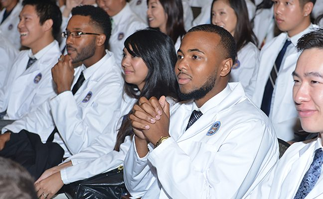 UCLA Dentistry Class of 2019 student dentists Ryan Gaw, Wayne Gonzalez, Roblen Guevarra, Delano Hankins, Jonathan Hoang, Ivana Lee, Nicole Lee, and Kevin Liang at the annual White Coat Ceremony.
