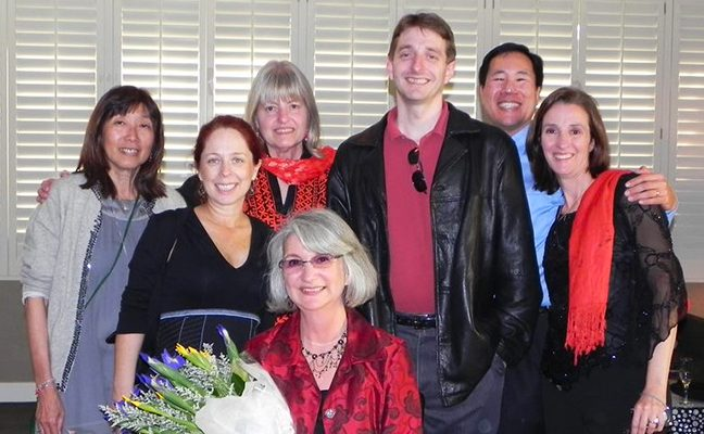 School of Nursing staff in back row, and Dean Linda Sarna, seated