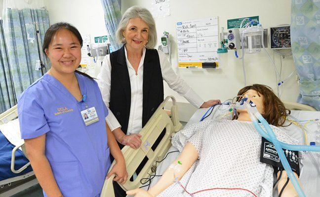 Mary Onglatco and Dean Linda Sarna, with Nursing manikin