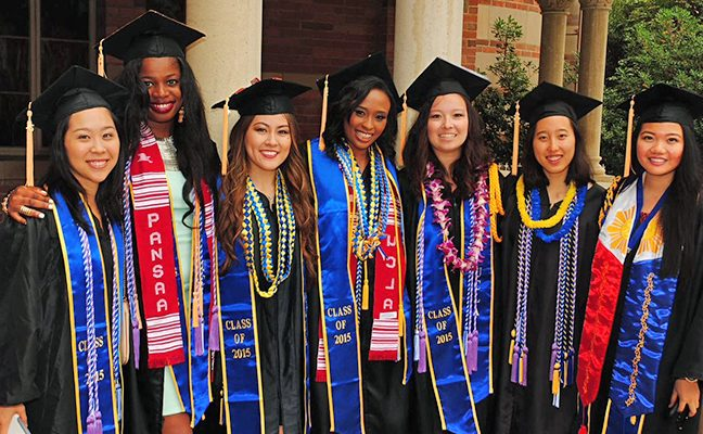 Seven nursing students in caps and gowns