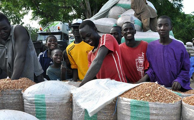 Cameroonian citizens with containers of crops