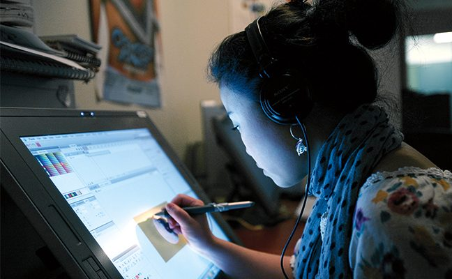 A student uses a computer to participate in the TFT Animation Workshop.