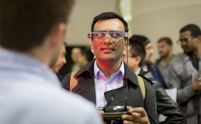 A man uses augmented reality technology.